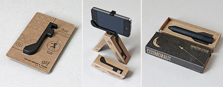 On the left, an image of our Glif packaging. In the middle, our Glif+ packaging, assembled into a bipod with an iPhone mounted to it. On the right, our Cosmonaut packaging. All of the packaging is a brown kraft paper color with black ink.